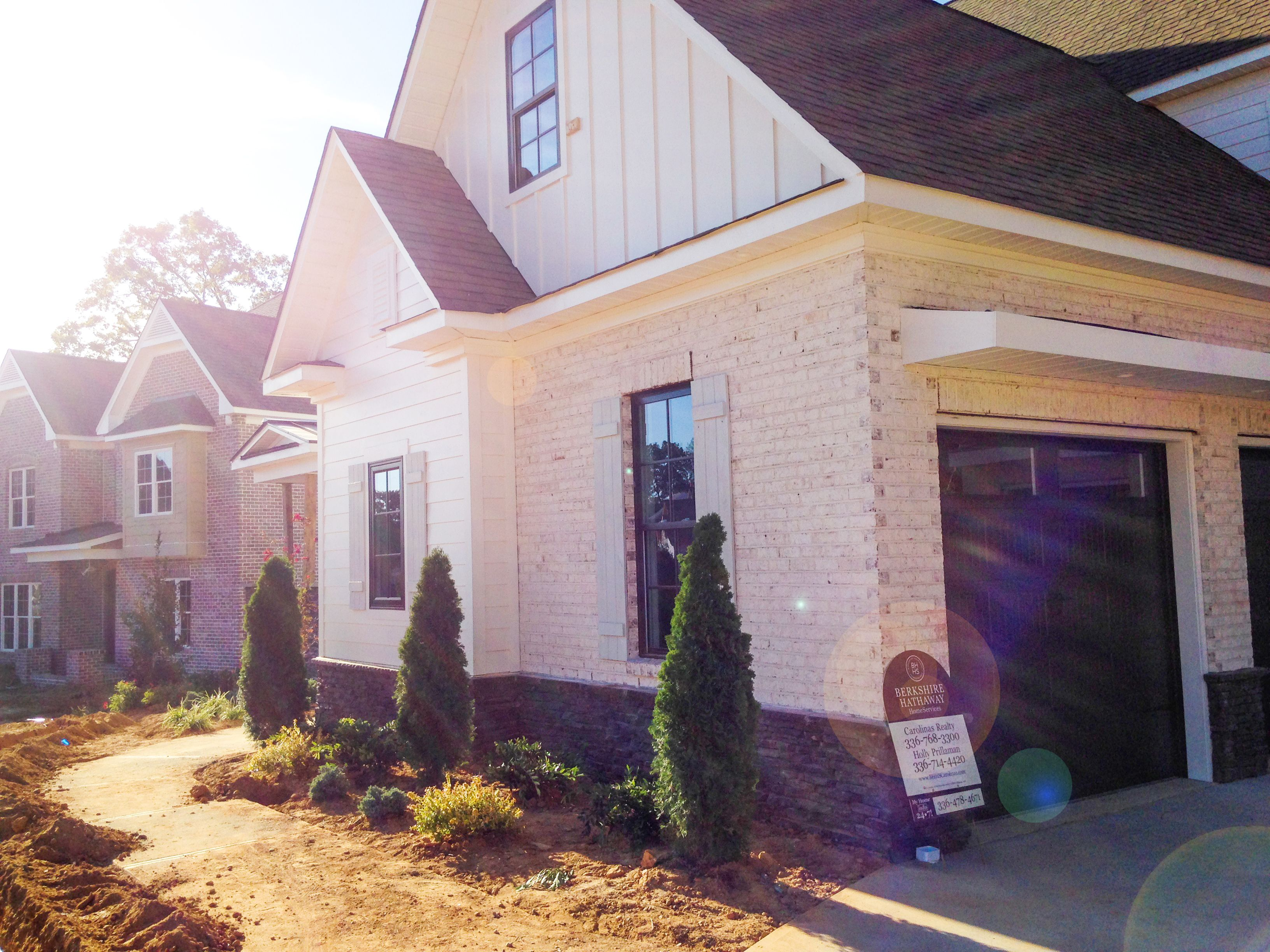 New Villa Chase Brick Exterior With Brown Trim Looks Inviting