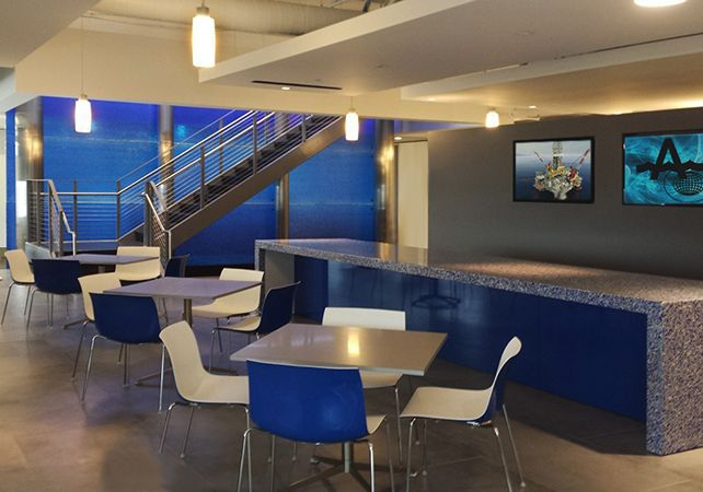 "Corporate Interior - Houston, TX  Glass Description:  Feature Wall  1/2"" Clear Tempered Kiln-Fired Glass  Texture: MD204 Strata  Fused Color: Cobalt Blue  30 Panels, Each 96"" W x 54"" H"