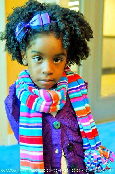 Little girl's got major natural hair style!