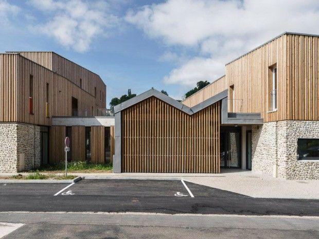 Ossatures bois et socles en béton pour un programme public mixte - maison en beton coule