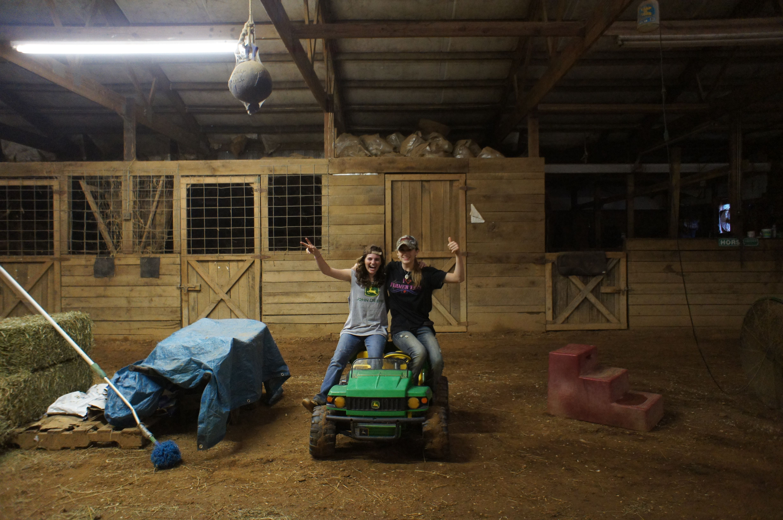 Me and addie on jacksons gator push lawnmower