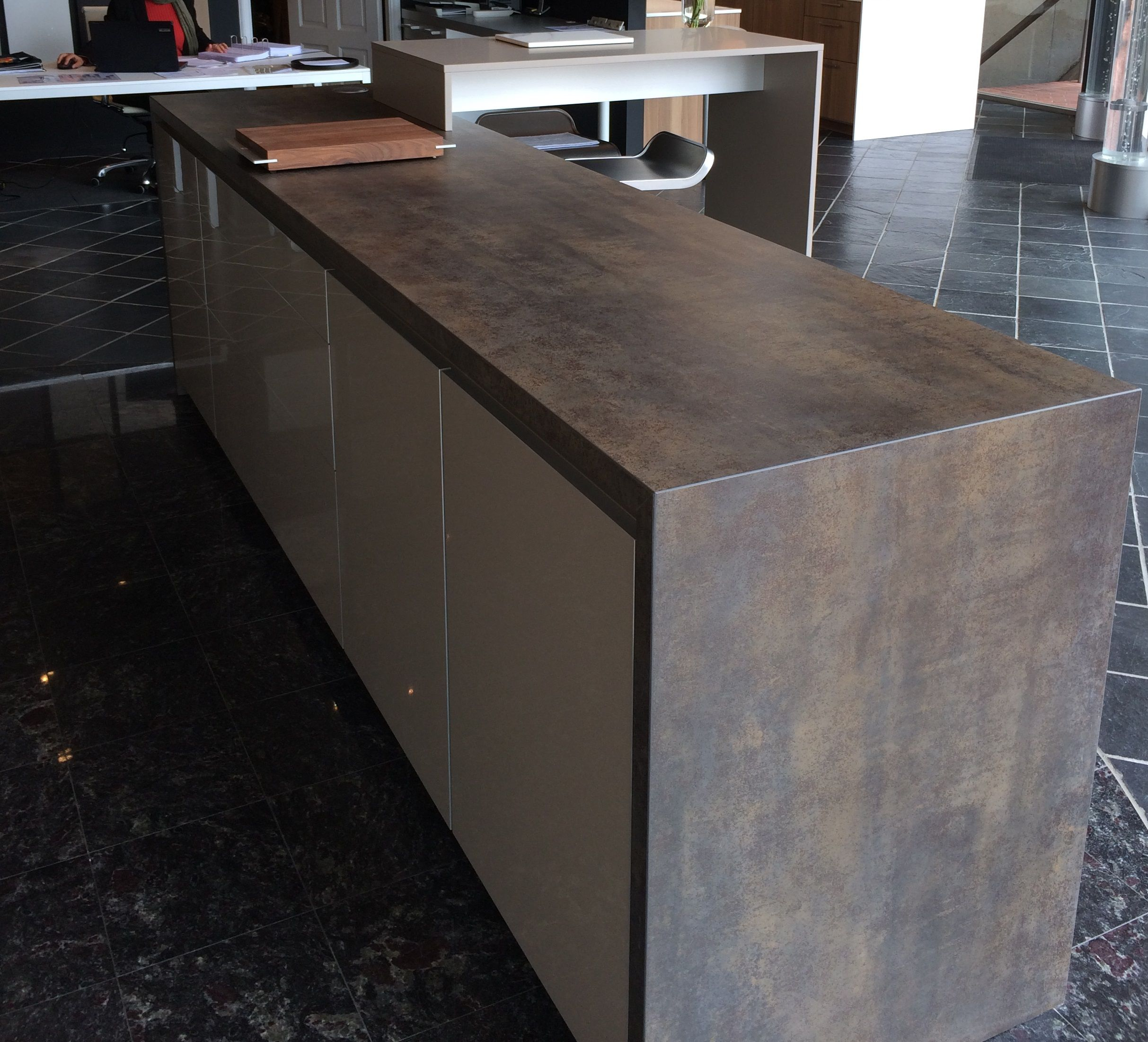 island with waterfall in iron moss neolith in the ultimate island with waterfall in iron moss neolith in the ultimate kitchen s showroom located in vancouver