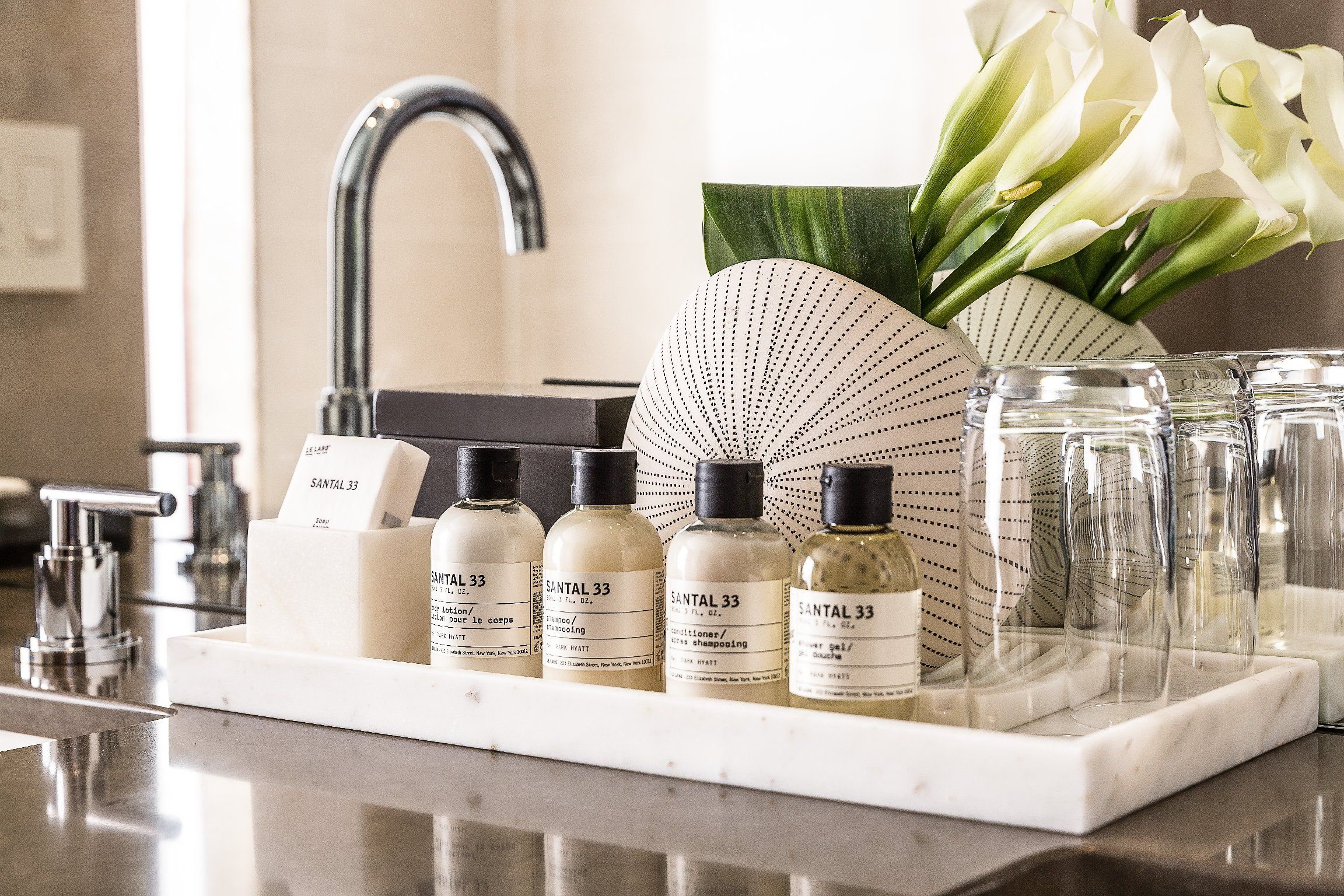 Suite bathroom amenities hotel amenities in 2019 for Leading small hotels
