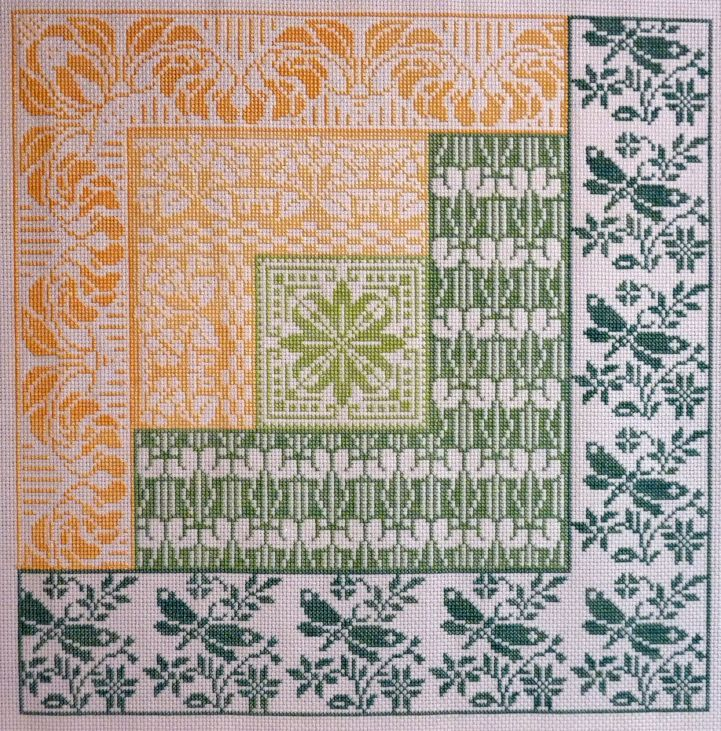 Cross stitch pattern in log cabin quilt style, with spring theme motifs