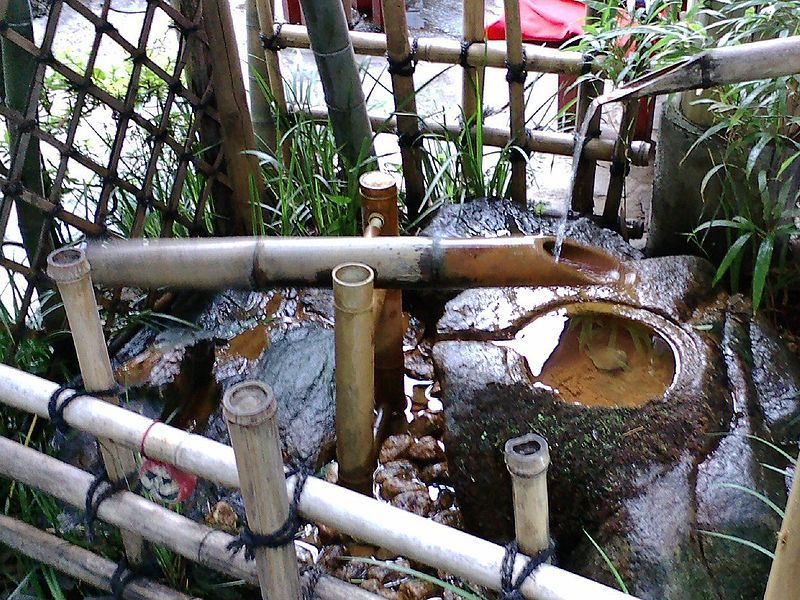 A Shishi Odoshi Breaks The Quietness Of A Japanese Garden With The Sound Of  A Bamboo Rocker Arm Hitting A Rock