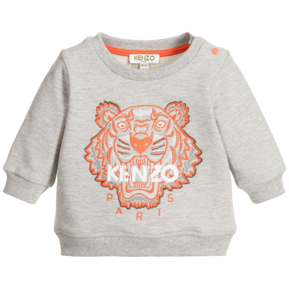 Baby boys grey 'tiger' sweatshirt by Kenzo. Made in mid-weight cotton sweatshirt jersey, it has an embroidered tiger on the front in orange. There are popper closures on one shoulder to help with dressing and it has a ribbed neckline, cuffs and hem with a cosy fleece lining.