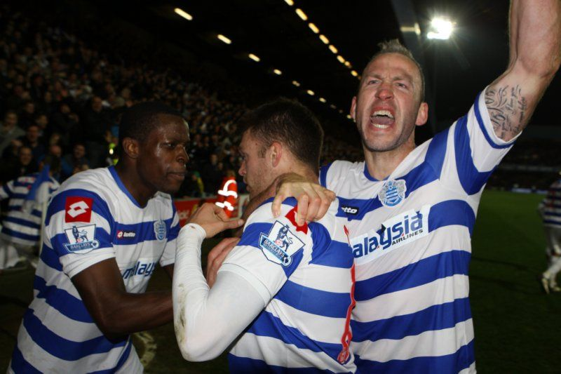 QPR players celebrate with Mackie after his goal put them 3