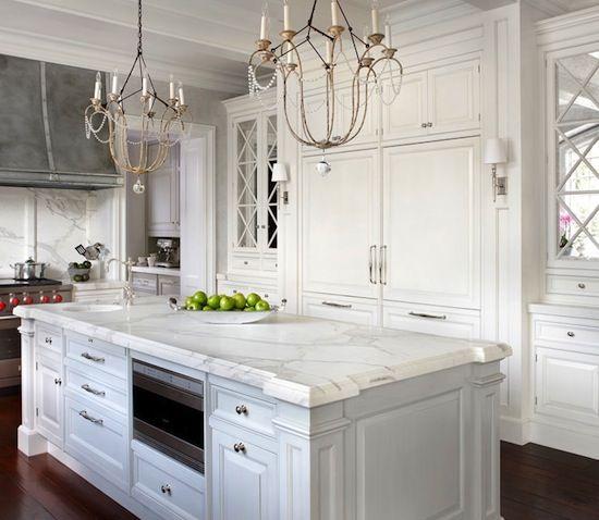 Gorgeous white and grey kitchen with elegant details.