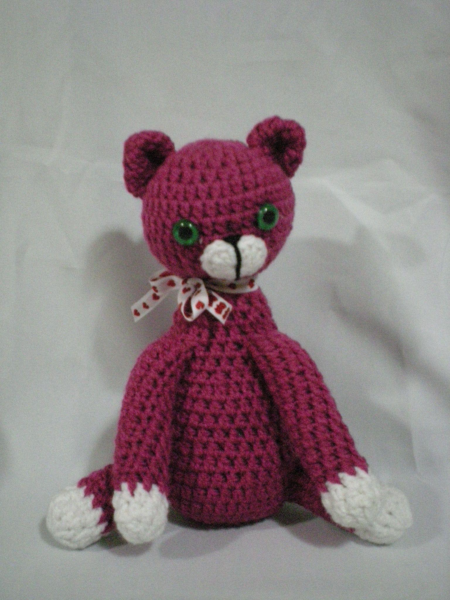 Gato rosa, sentado