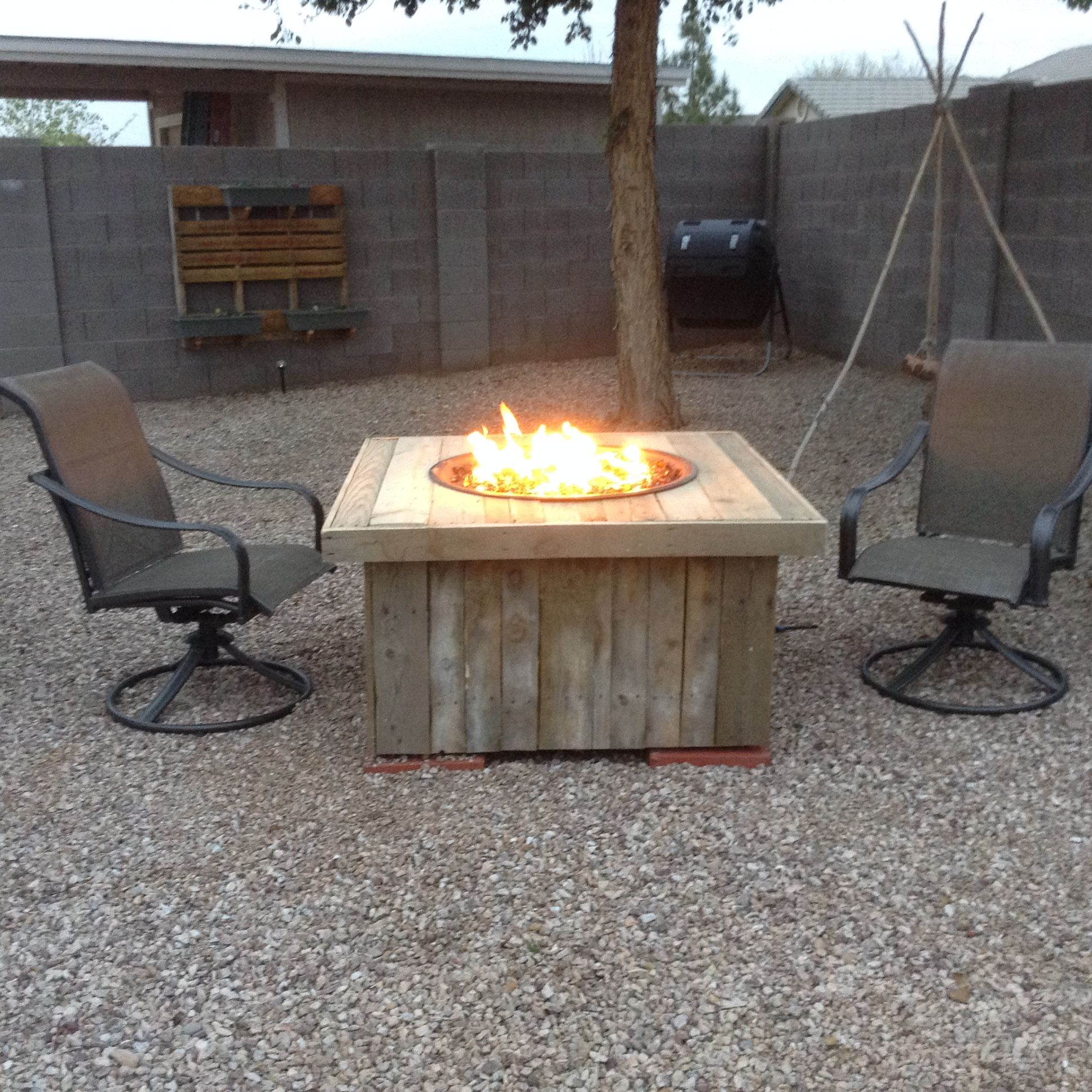Firepit My Husband Built For Me He Converted A Cheap Wal Mart Wood Burning Pit To A Gas Pit Framed With Pallet Wo Fire Pit Gas Firepit Wood Burning Fire Pit