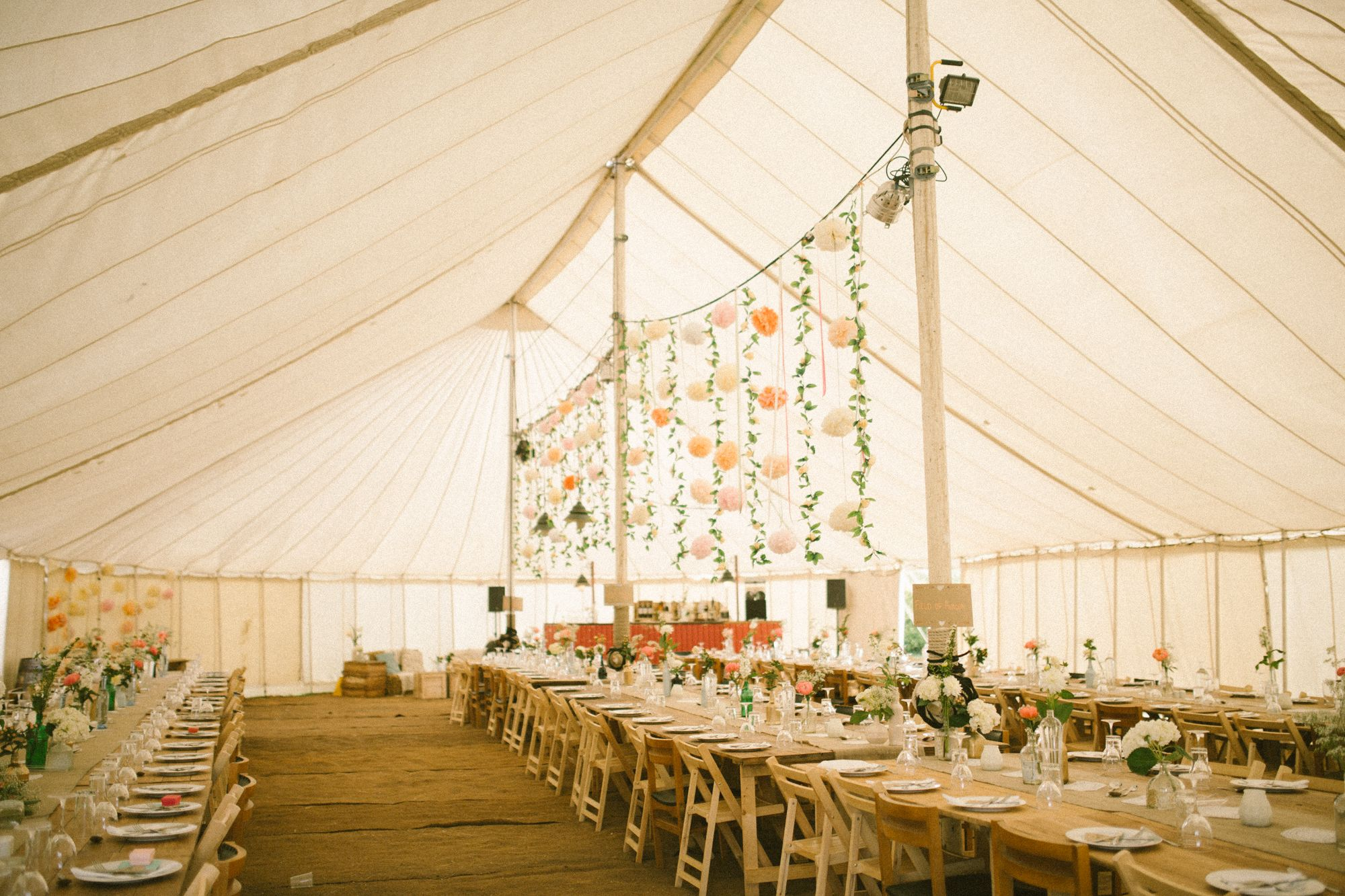 We had beautiful old fashioned tents with coco matting floor. Giant pom poms courtesy of : homemade wedding tent - memphite.com