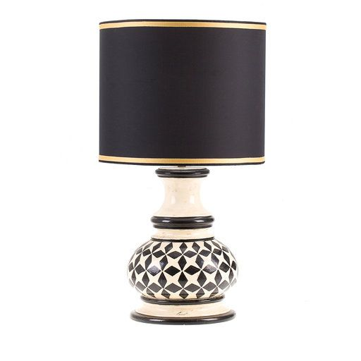 Delicate ceramic lamp inspired by a model dating to the the lamp is entirely crafted and painted by hand in black on an ivory background by the
