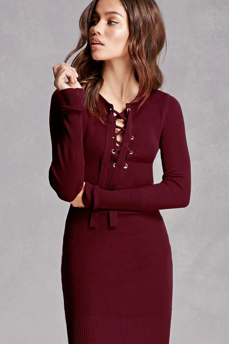 A sweater-knit dress by Hera Collection™ featuring a lace-up front with  grommets 1fc5a66523