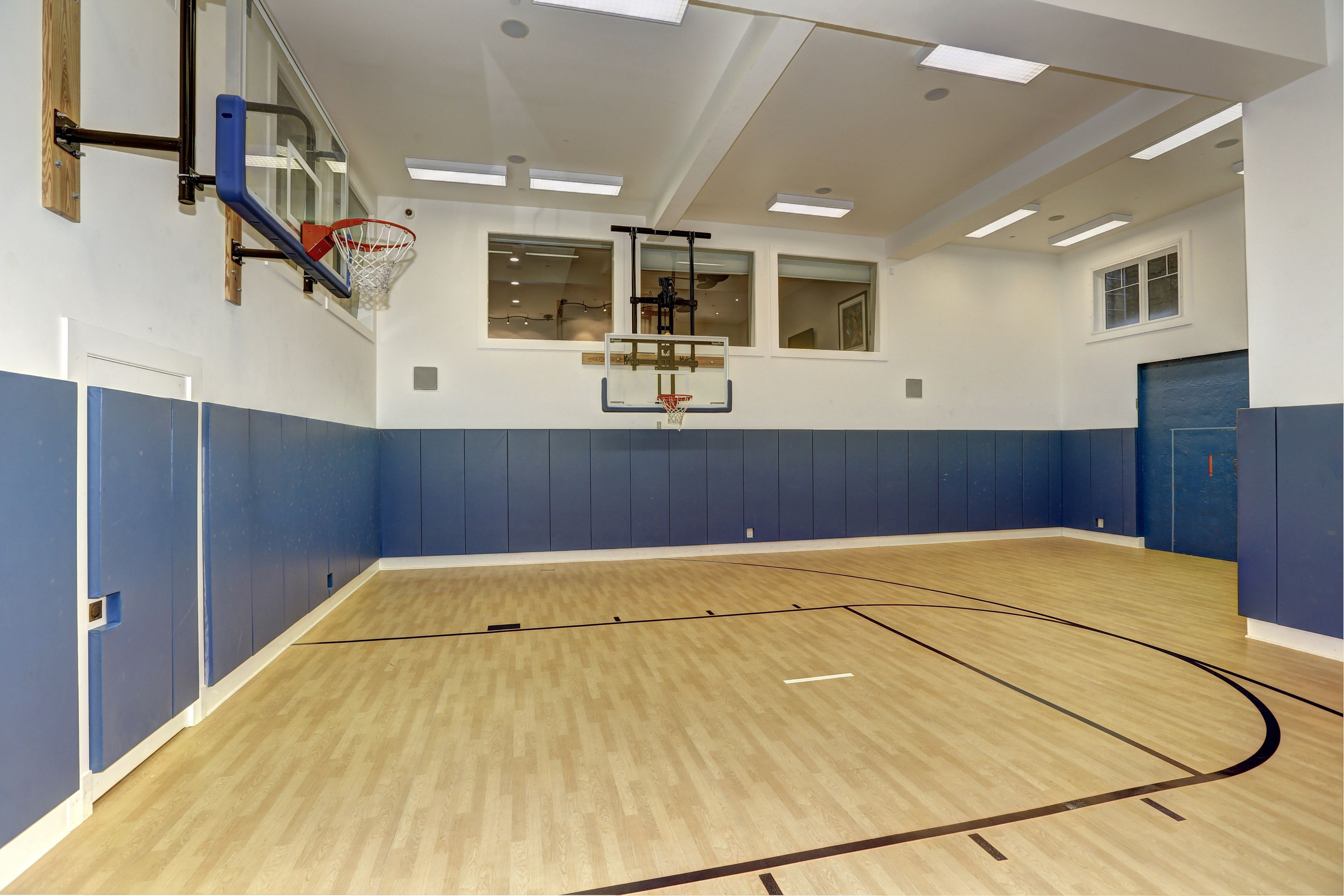 7700 Oldchester Road In Bethesda Maryland The Fully Finished Lower Level Is Enhanced By An Ind Indoor Basketball Court Guest Suite Indoor Basketball