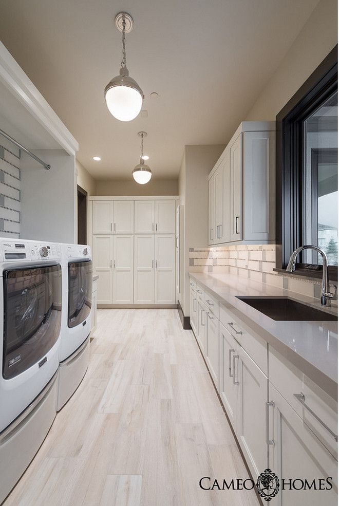 Laundry Room With White Cabinets Gray Quartz Countertop