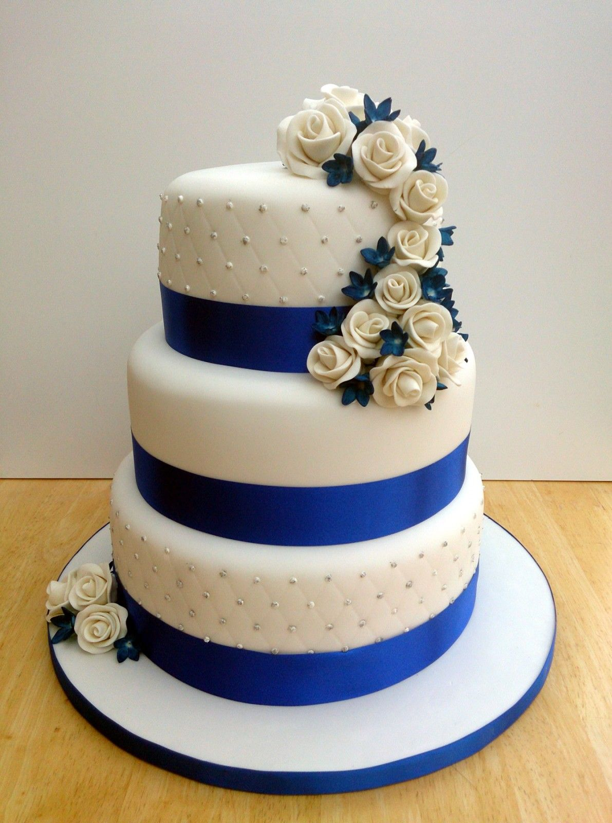 3 tier round stacked wedding cake with sapphire blue and white 3 tier round stacked wedding cake with sapphire blue and white izmirmasajfo