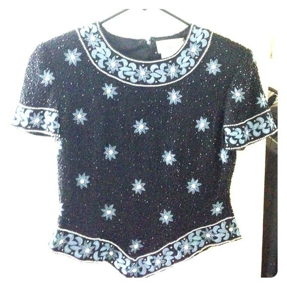 Vintage Beaded blouse with Embroidery Black beaded blouse with grey embroidery and silver beads. Beautiful. Size Petite Small. Bust is 32 inches. Length front is 18.5 inches length back is 19 inches. Waist 32 inches. Beads in tact. Excellent condition. Vintage Tops Blouses