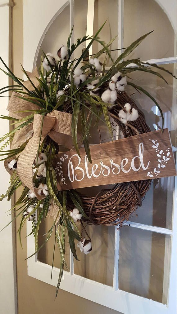 Photo of This farmhouse wreath is full of natural greenery and cotton stems, beautiful fo …
