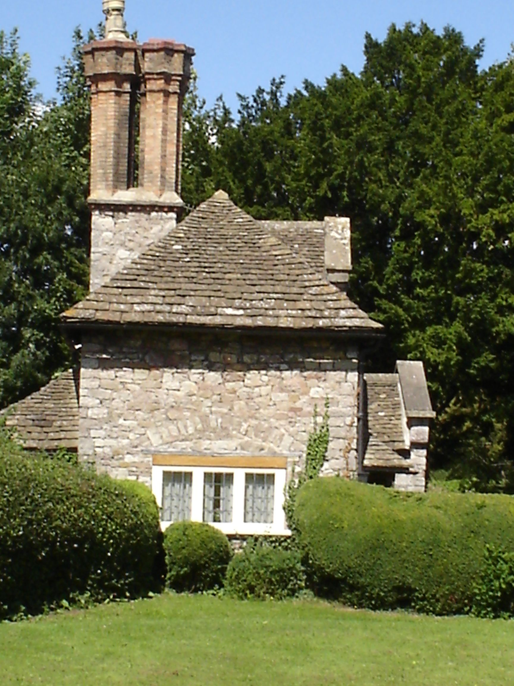 Great dual chimneys on cottage in Blaise Castle Hamlet in Bristol, England