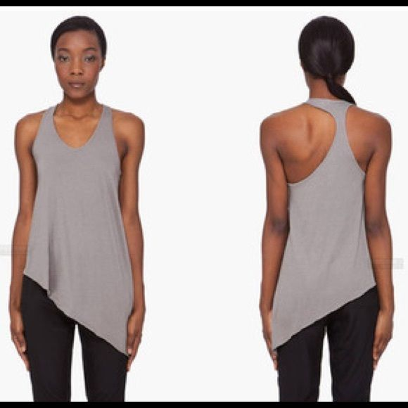 Helmut Lang Feather Jersey Asymmetric Tank Top Super fun top in soft lightweight cotton. Beautiful cut that is so flattering. Racerback. In good condition. No rips no stains. Color is a grayish olive hue. Retails for $125 new. Helmut Lang Tops Tank Tops