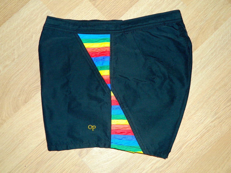 3ce4f6d394ce2 vintage 1980s Op shorts black nylon surf swim trunks 30. $36.00, via Etsy.