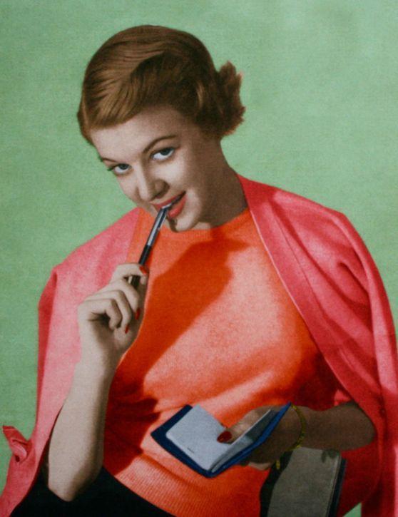Model wearing a classic twin set, 1950s