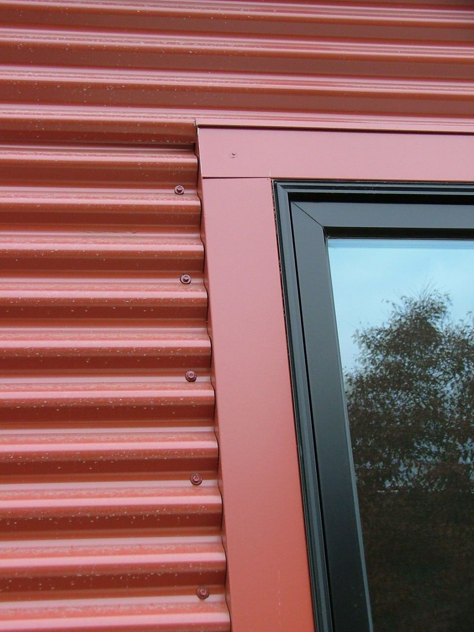 Metal Frame Window Panels : Detail with window frame corrugated steel siding