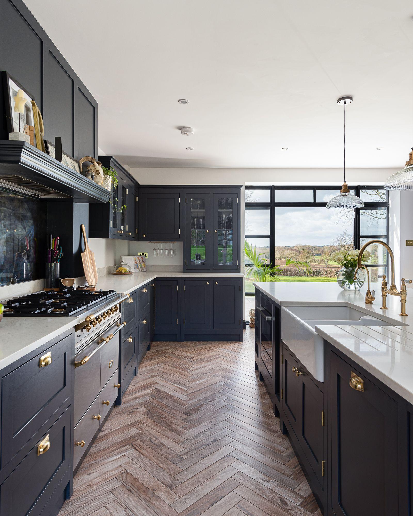 Dark Shaker kitchen with parquet floor