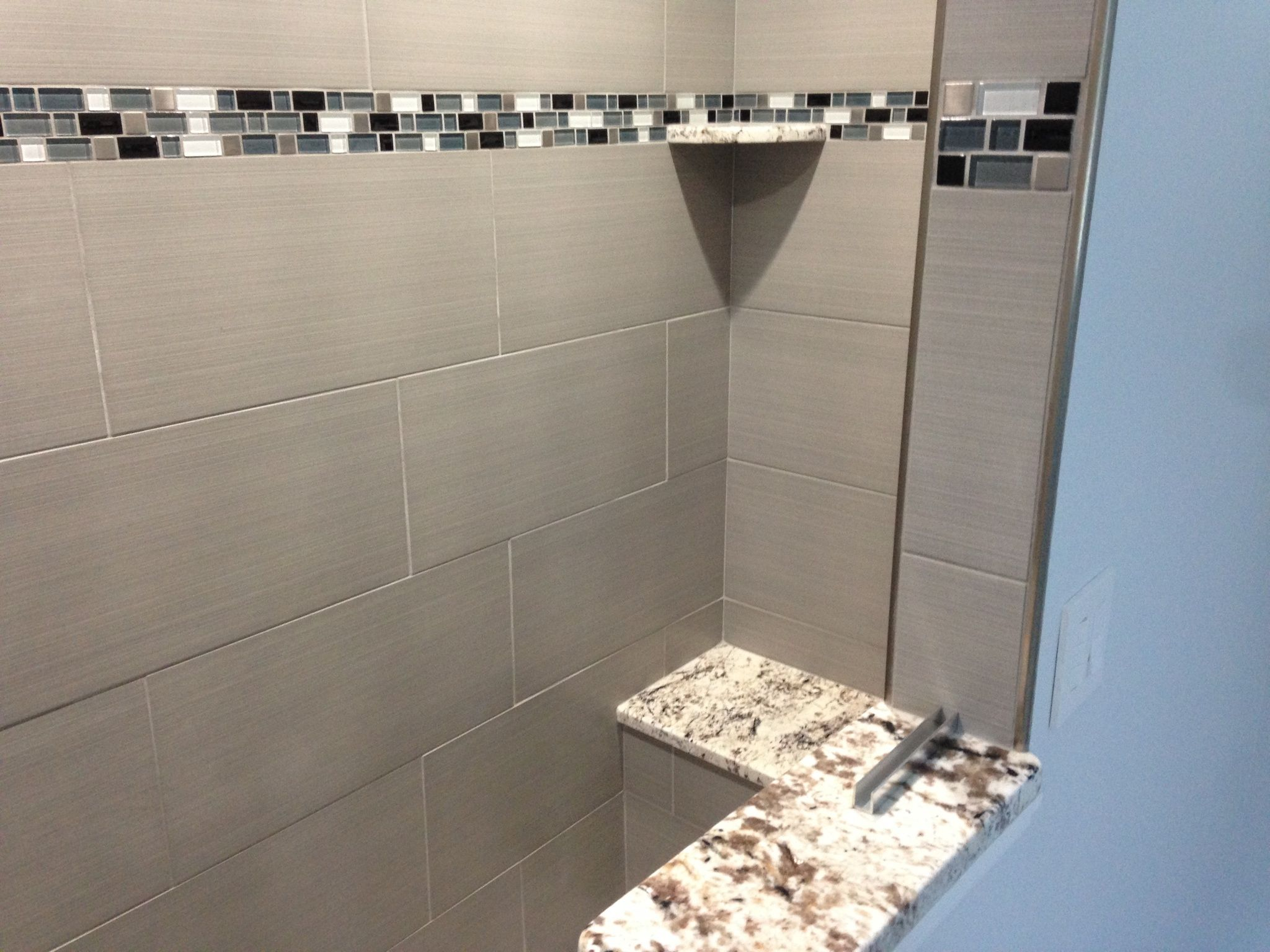 Entry View Of A Schluter Walk In Shower With NeosTile Series Tile, White  Venatino