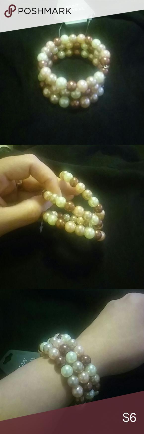 Multi-colored pearl bracelet 3 row pearl bracelet. Never worn. Jewelry Bracelets