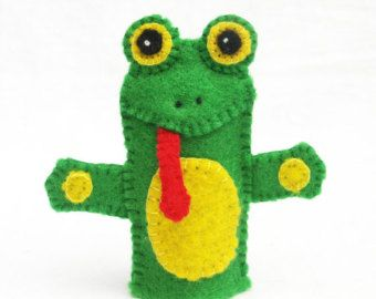 Made from 100% wool felt, this finger puppet is about 2.5 inches tall. Each piece is hand cut and hand sewn together one tiny stitch at a time. Attention to detail is given to both the front and the back. No glue or beads are used.