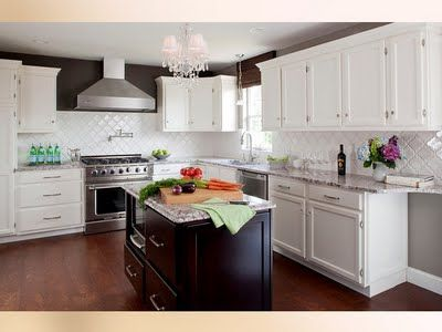 Beautiful Example Of White Cabinets With Exterior Brushed Nickel Hinges   Corner