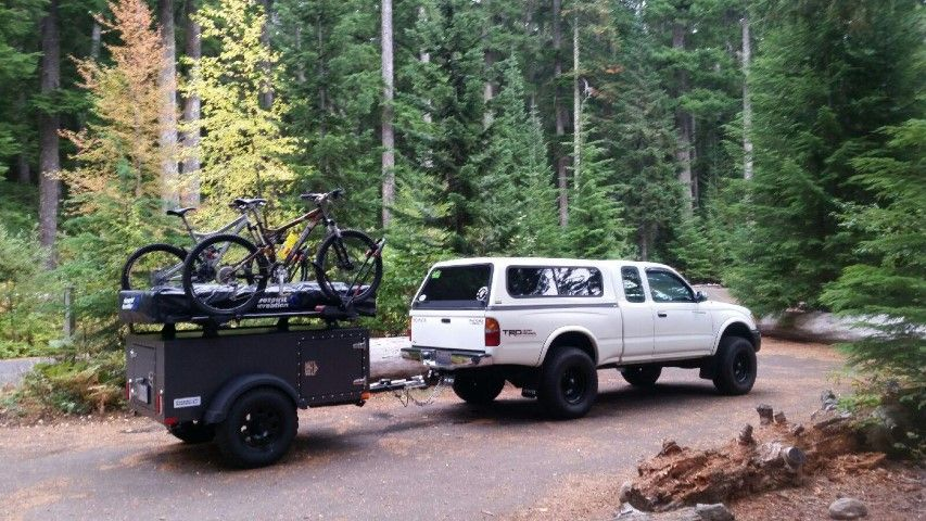 A mountain bikers roof top tent trailer. Top tents, Tent