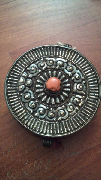 A Tibetan amulet (gau)  silver with coral  Posted by Howah Chen