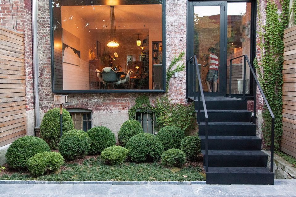 Brooklyn brownstone stair into backyard with shrub garden for Apartment yard design