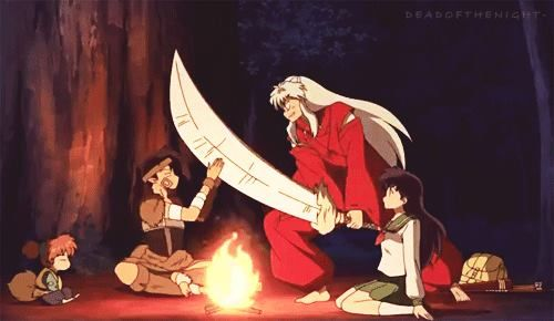 Koga Blocking Inuyasha S Sword Sitting Around A Fire With Kagome And