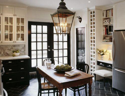 kitchen - black lower cabinets, white uppers, marble countertop, slate herringbone floor, pretty lantern, black french doors