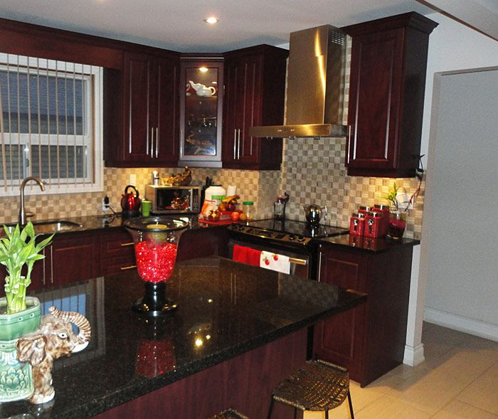 mahogany kitchen cabinets and with black granite countertop – Mahogany Kitchen Cabinet