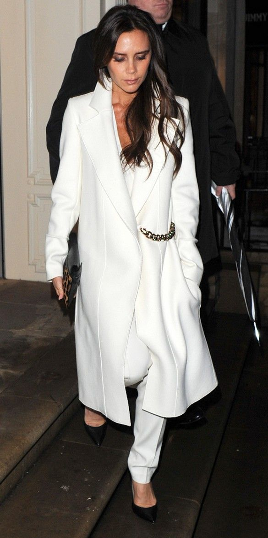 ... fashion. Victoria Beckham elegantly wears her winter whites  white coat    white trousers. cfa6b7121