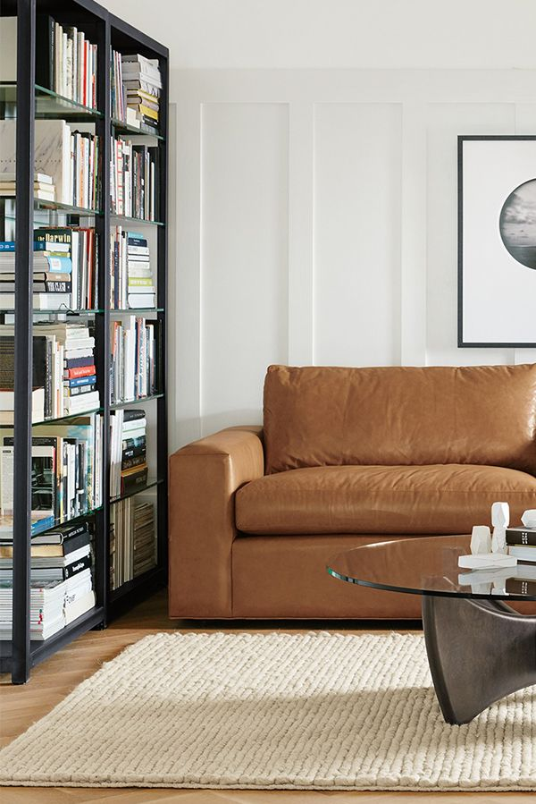 Nice A Hand Welded Natural Steel Frame Supporting Glass Shelves Gives The Burton  Bookcase An Industrial Ideas