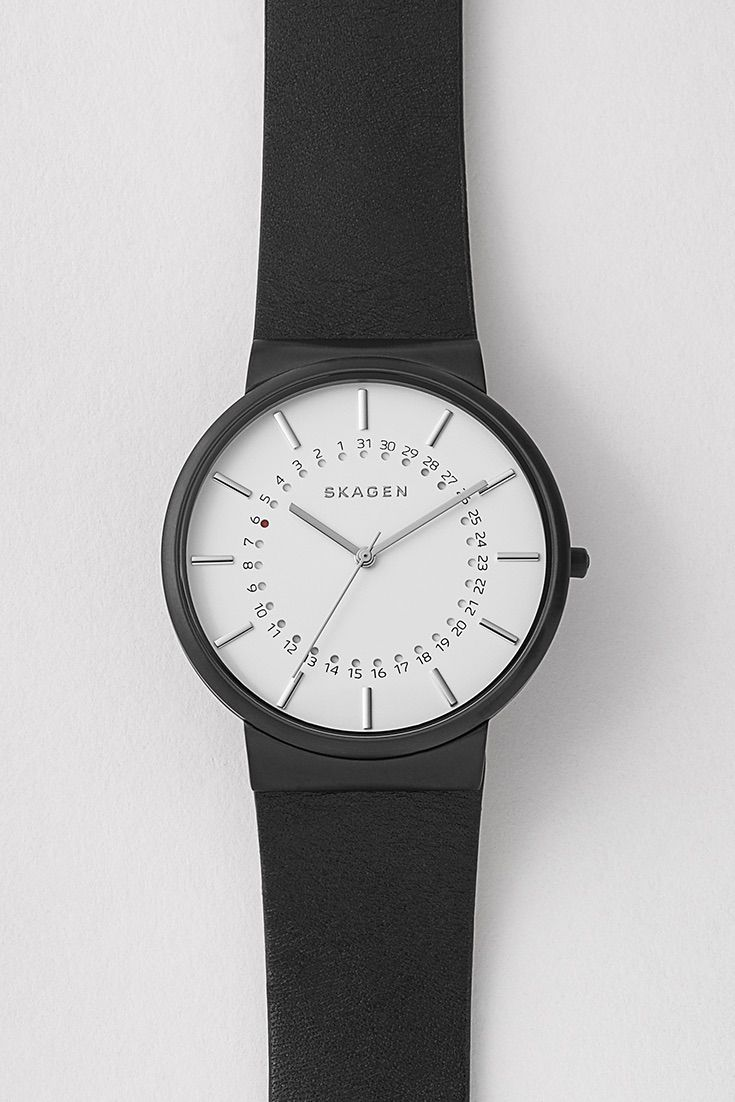 Our Ancher Leather Watch is sophisticated and functional, with a soft leather band. Echoing the orbit of a planet, the moving dot underneath the dial indicates the date.