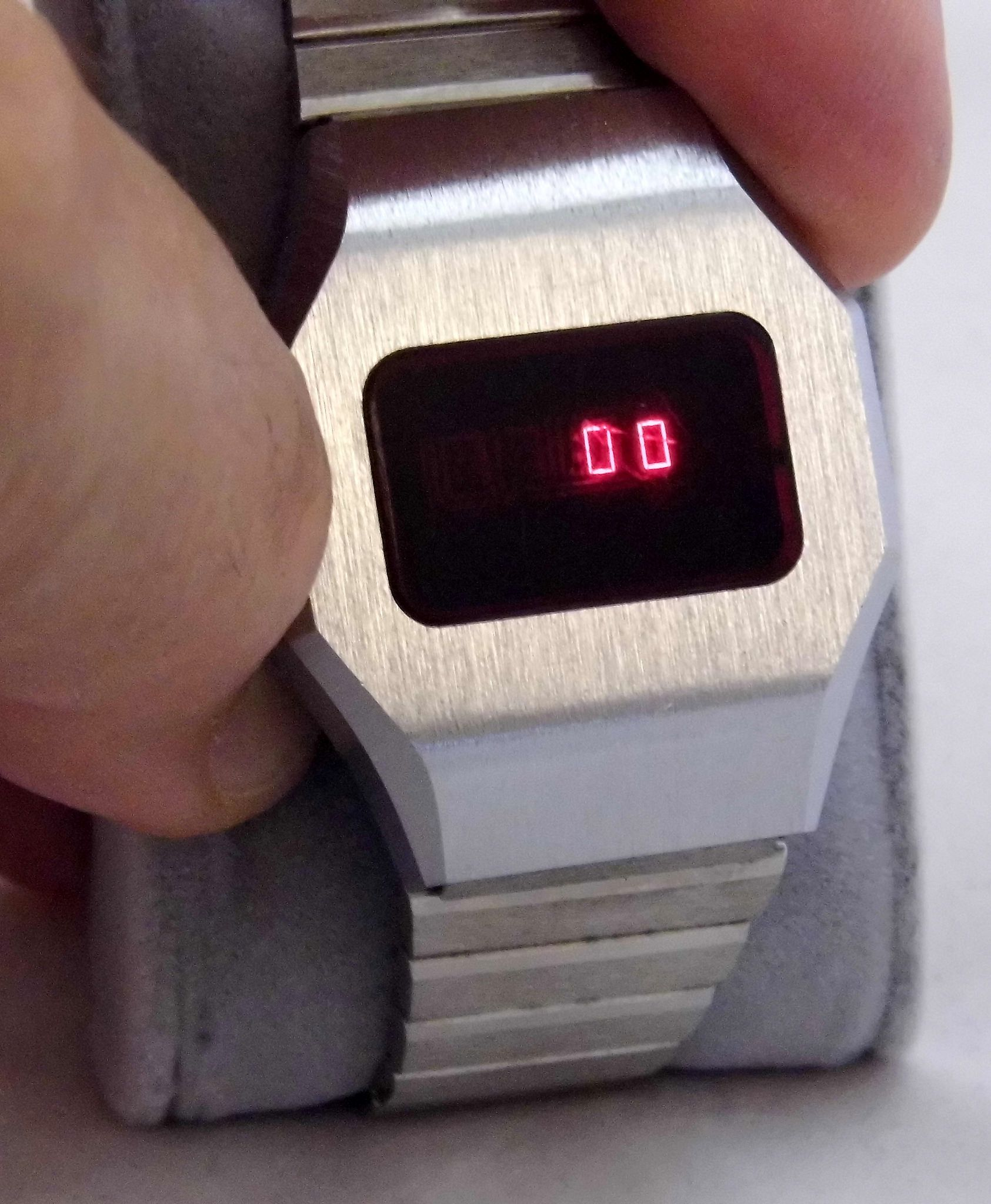 https://flic.kr/p/uH4cAC   Vintage Men's Red LED Wrist Watch With Original Band, Manufacturer Unknown. Case Marked Made In Hong Kong, Circa 1970s