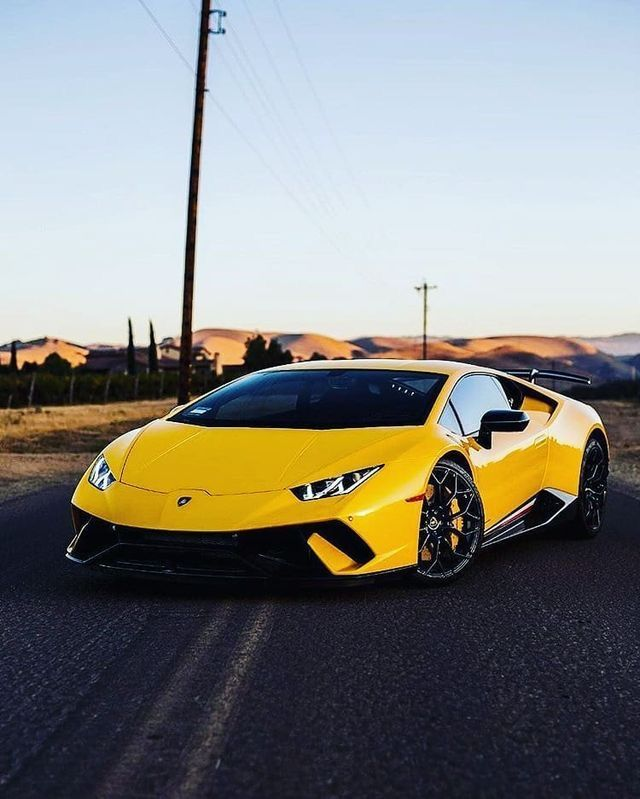 Yellow Lamborghini photography Perfect wallpaper for your iPhone if you're looking for expensive
