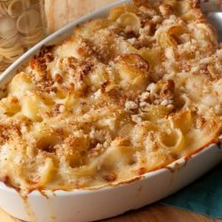 Panera Bread's Signature Macaroni & Cheese Adapted by Head Chef Dan Kish  Ingredients 1 (16-ounce) package of rigati pasta (or other small pasta shells) ¼ cup butter ½ cup all-purpose flour 2½ cups 2% reduced fat milk (or cream) 6 slices white American cheese, chopped 1 cup (8 ounces) shredded extra-sharp white Vermont cheddar 1 tablespoon Dijon mustard 1 teaspoon kosher salt ¼ teaspoon hot sauce  Directions 1.Prepare pasta according to package directions. 2.Melt butter over low heat. Whisk…