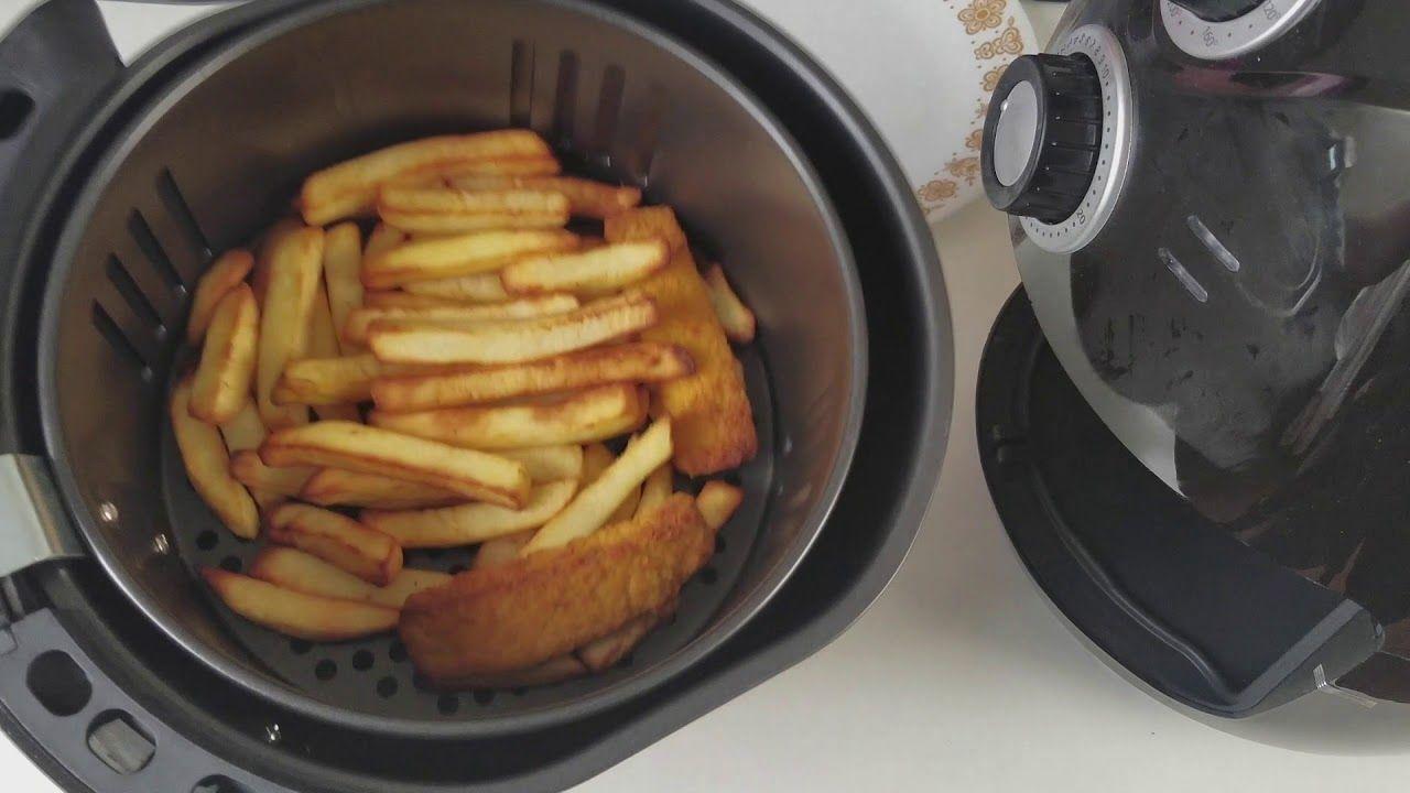 Air fryer cooking frozen chips fish fingers air