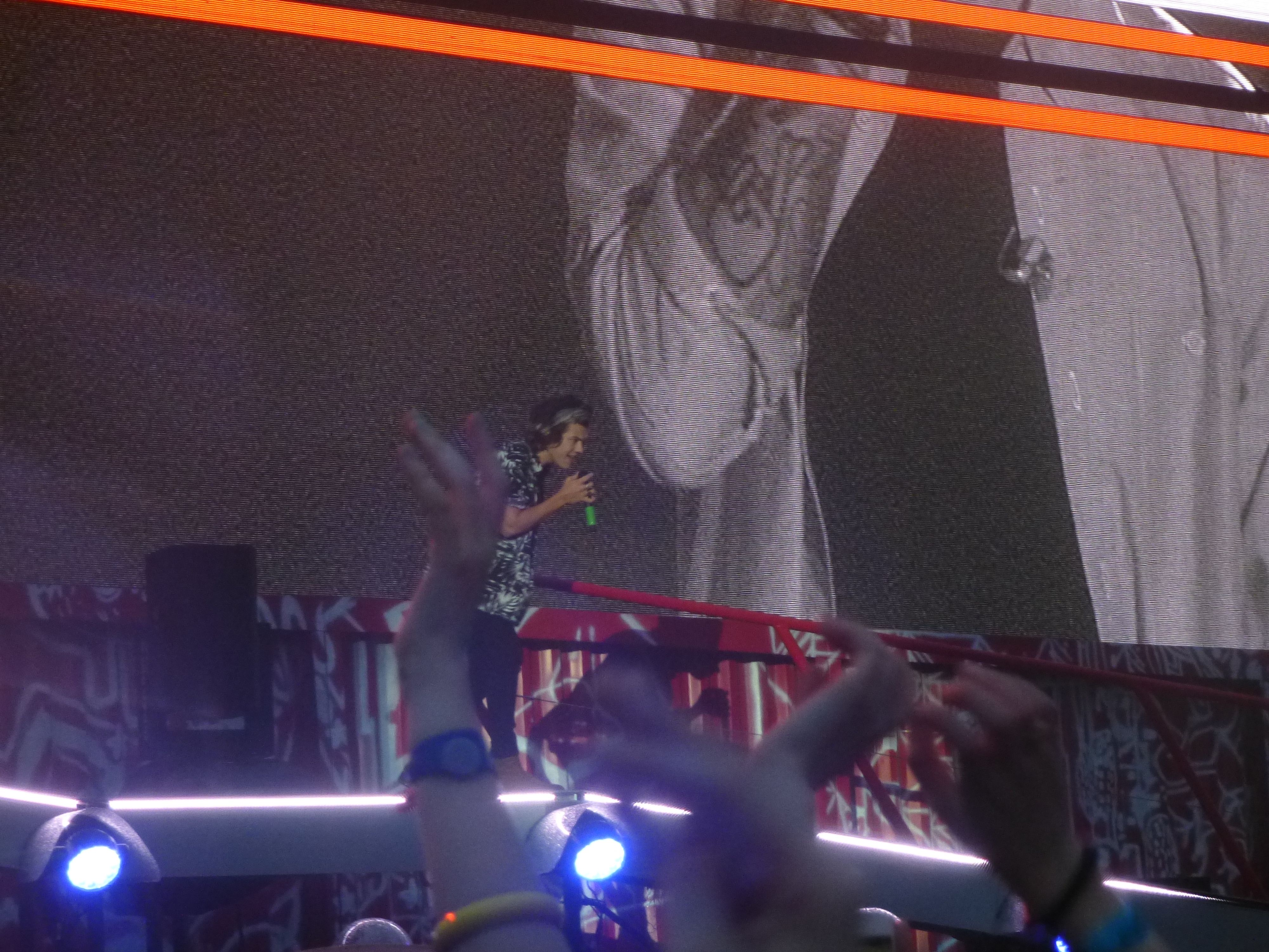 Harry on stage and Zayn on the big screen in Croker