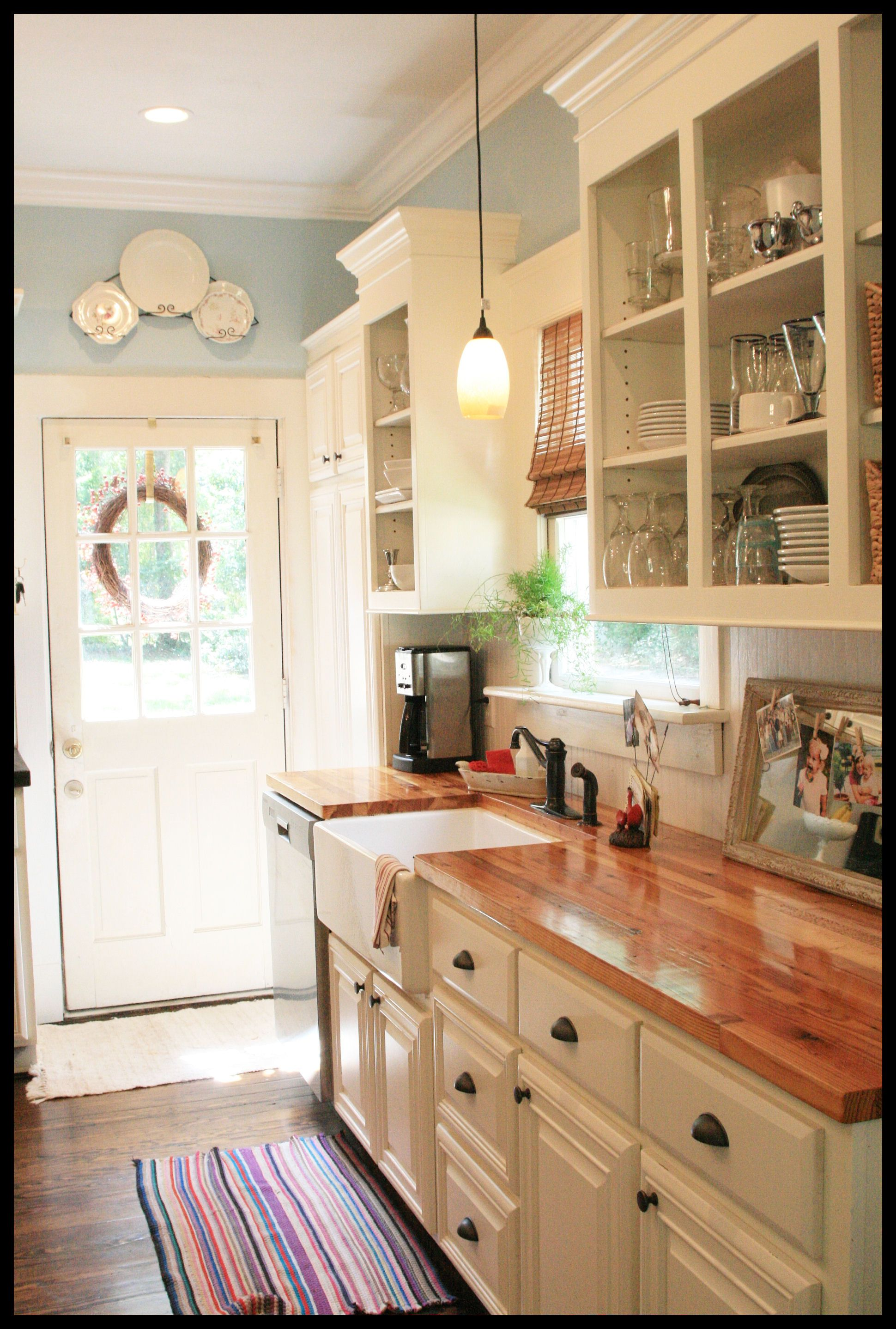 White Cabinets Butcher Block Countertops Farmhouse Sink And Pretty Blue Walls I Love This Maybe Not So Much The But Cabinetry