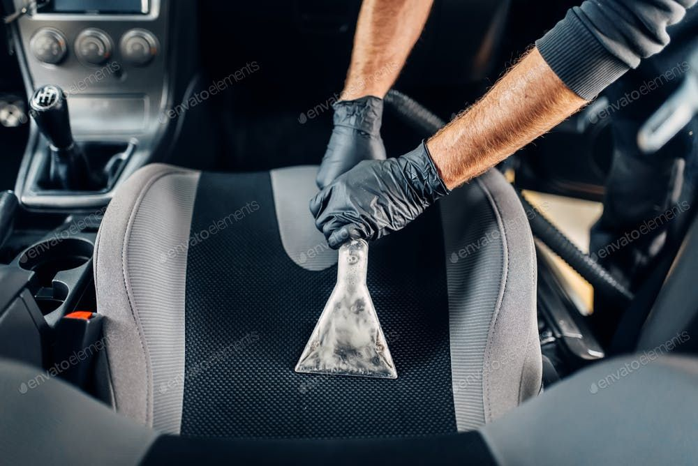 Dry cleaning of car interior with vacuum cleaner By