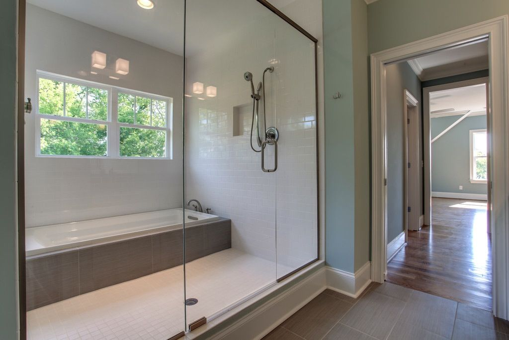 """Wet Room"" combines shower and bathtub keeping all water features contained in one area. Great space saving technique."