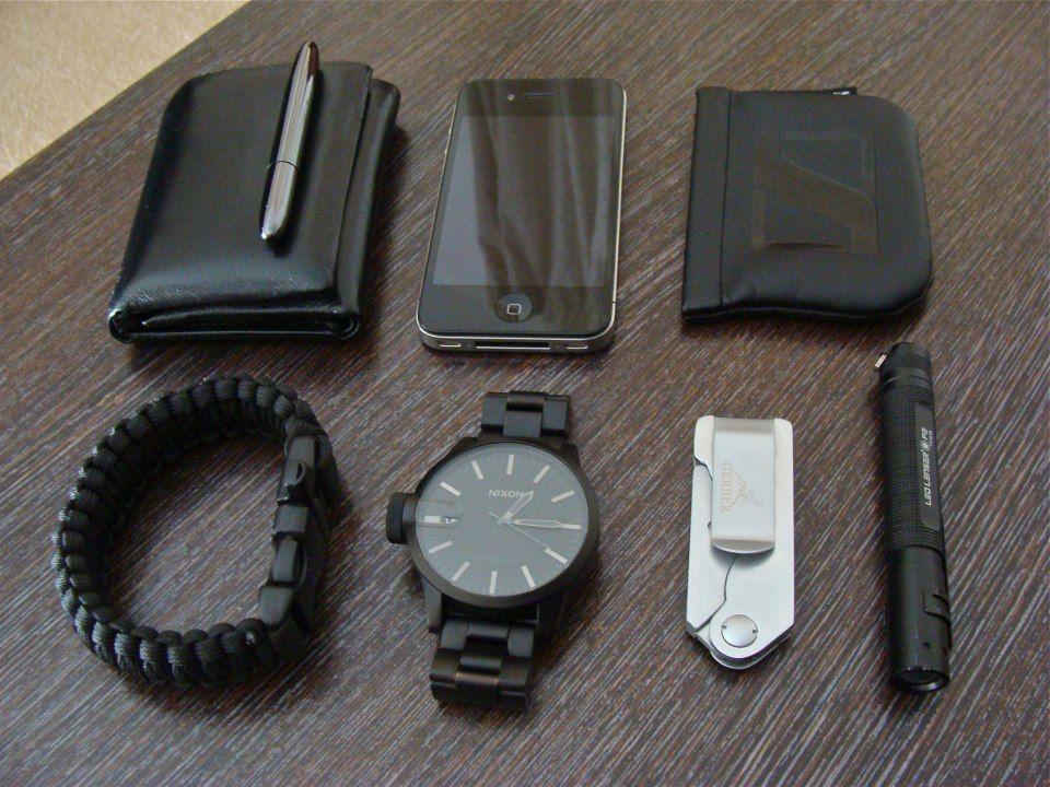 Tri-fold Nappa Leather Wallet - Black Titanium Nitride Space Pen - iPhone 4 -  Sennheiser CX300II - LED Lenser P2 Torch -  Gerber EAB Pocket Knife -  Nixon Chronicle - Black Paracord Bracelet with Whistle Buckle